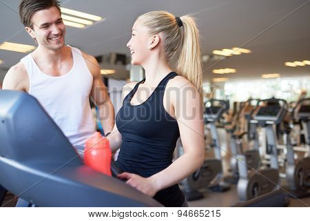Happy Pretty Girl With Her Trainer Inside The Gym