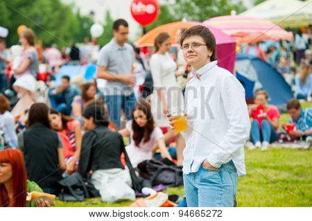 MOSCOW - JUNE 20, 2015: Young woman drinks beer on XII International Jazz Festival