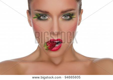 Young Woman With Strawberry In Mouth