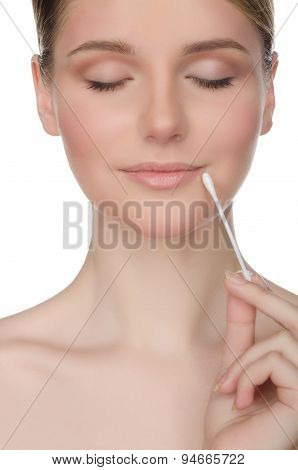 Beautiful Woman Holding Cotton Swabs At Mouth