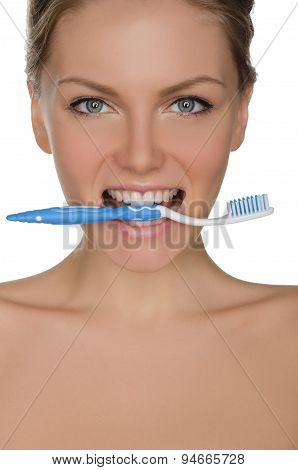 Portrait Beautiful Woman With Toothbrush In Teeth