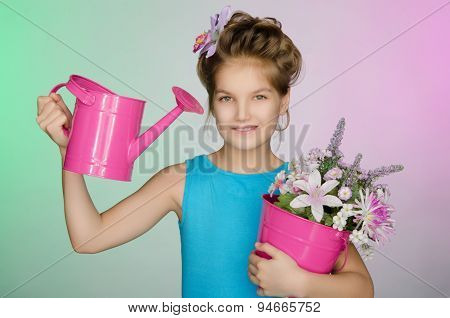 Happy Girl With Watering Can And Beautiful Flowers