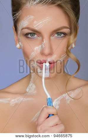 Woman With Toothbrush And Toothpaste On Body