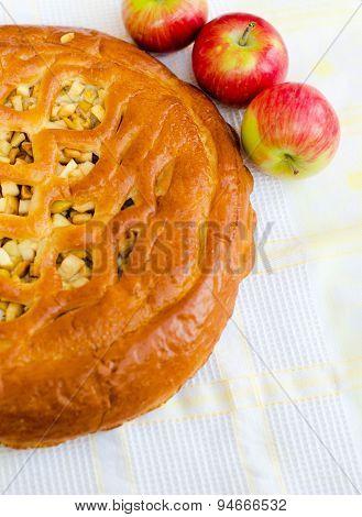 Golden Crispy Apple Pie On White Fabric