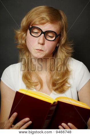 Woman In Funny Old-fashioned Glasses Reading Book