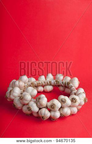 Red Background With A Wattled Garlic Round
