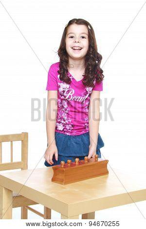 Dark-haired girl in a Montessori kindergarten