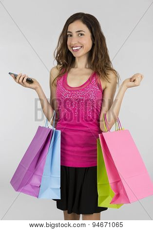 Shopping Woman Smiling And Holding Her Smart Phone