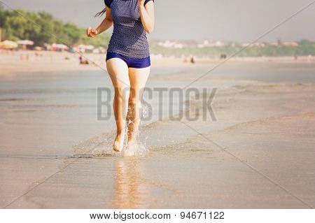 Healthy woman running on the beach, girl doing sport outdoor, happy female exercising, fitness and h