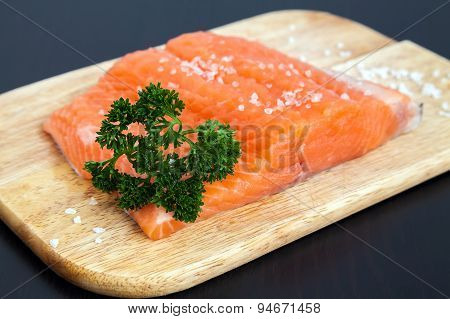 Raw Salmon Fillet With Salt And Parsley