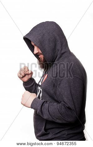 Boxer with a serious face with a beard in the hood in training. Isolated on white background.