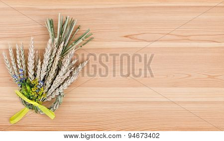 Bundle Of Wheat With Flower And Band