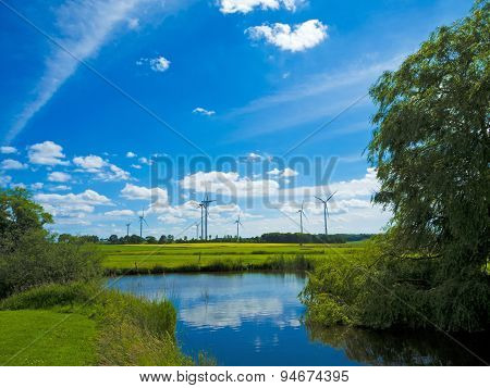 landscape with pond and wind farm