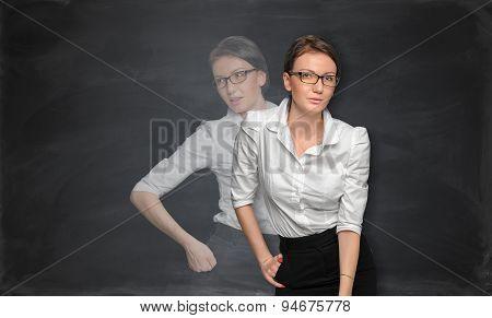 Woman tanding near the blackboard