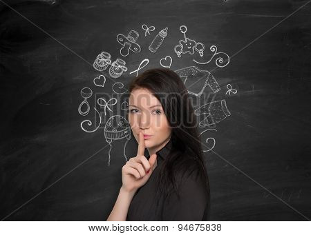Woman on a blackboard background with starting family doodles