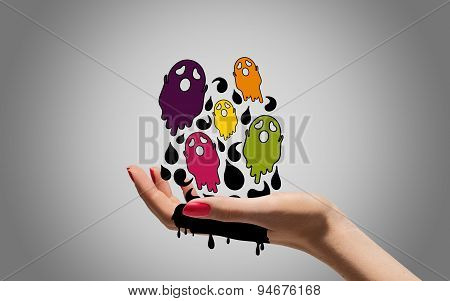 Cartoon ghosts with woman hand