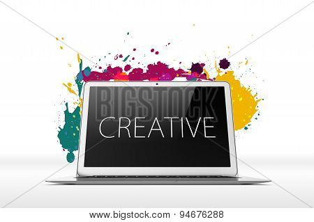 Open laptop on white background with splatters