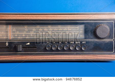 Old radio on blue background