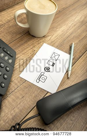 High Angle View Of Phone, Coffee, Pen And Notepad