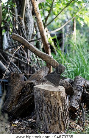 Old Axe, Log And Old Firewood