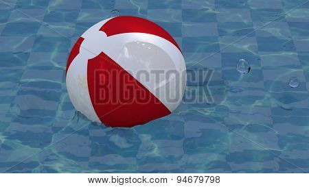 Red white beach ball in the pool