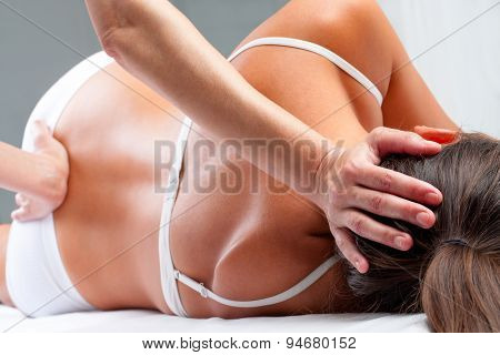 Osteopath Doing Cranial Sacral Exercise On Woman.