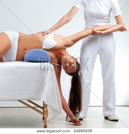 Therapist Doing Shoulder Massage On Woman.