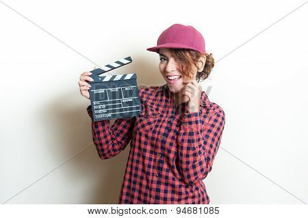 Smiling Girl With Movie Clapper On White Background