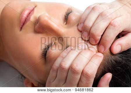 Woman Receiving Massage On Forehead.