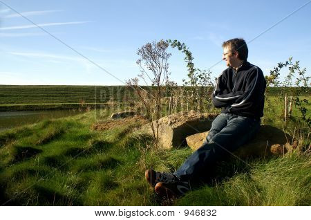 Man Relaxing In Countryside