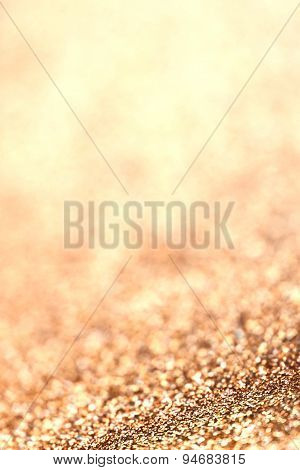 Abstract Christmas Glitter Background With Golden  Lights. Festive Defocused Background.