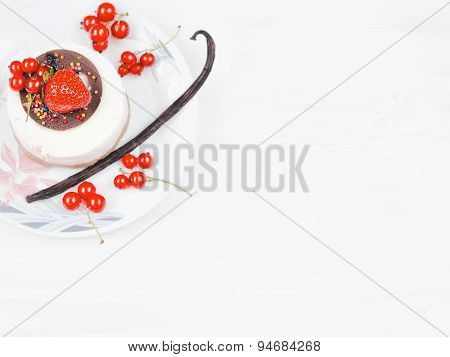 Cakes with berries on a white plate