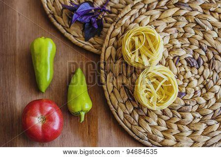 Pasta Nests, Tomato, Pepper, Basil On A Board