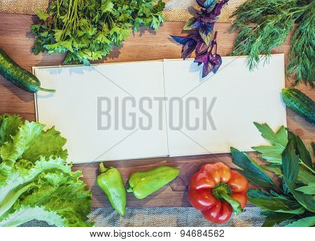 Frame Of Greens, Lettuce And Vegetables Around The Book