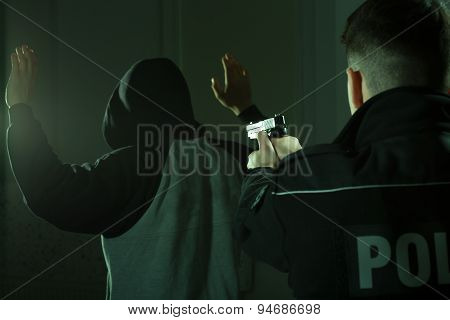 Officer Keeping Gun On Crook