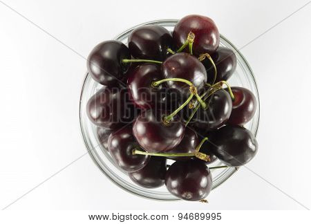 Cherries ( Dark Red)  In A Round Glass Salad Bowl
