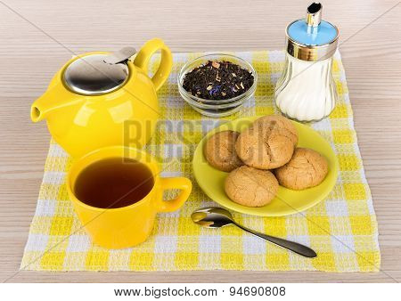 Kettle And Cup Of Hot Tea, Sugar And Biscuits
