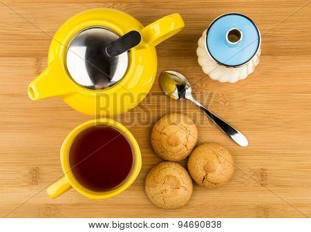 Kettle And Cup Of Tea, Sugar And Biscuits On Table