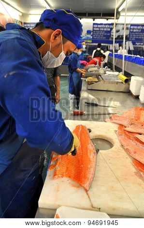 Ho Chi Minh City, Vietnam - October 8, 2013: A Worker Is Filleting Salmon In A Seafood Supermarket I