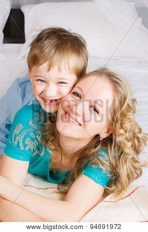 Close up of smiling mom and son