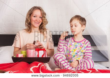 Happy mother and son having breakfast