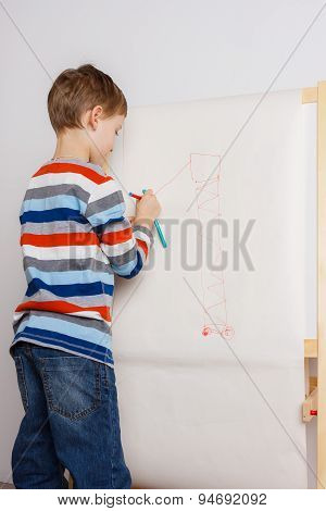 Little child drawing picture on easel