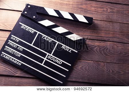 Cinema, clapboard, director.