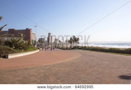 Early Morning People On Beach Front Promenade