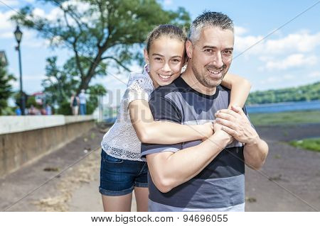 Father and daughter have fun outside