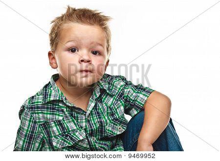 Adorable Little Boy Looking Pensive.