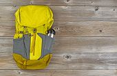 picture of canteen  - Weather proof backpack with metal canteen on rustic wooden boards - JPG