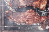 image of charcoal  - fresh hot bbq grill red beef meat steak ready on grid over charcoal with marks - JPG