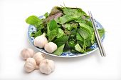 foto of laxatives  - Herbs and garlic on a white background - JPG