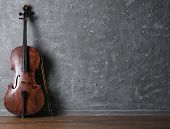 picture of cello  - Classical cello and bow on gray wall background - JPG